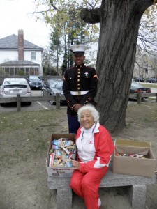 United States Marine Kyle Pina, PFC, and his grandmother, Doris Kelly, display the boxes of protein bars collected by Tucker students as part of a drive to help support the troops