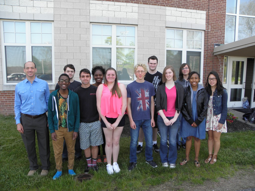 The staff of MHS Newspaper, Elephant in the Room. From left:  Advisor and MHS English Teacher Michael Young, along with newspaper staffers Zawadi Dore-Tyrell, Cole Salamone, Nathan Liberty, Orlane Destin, Meredith McGroarty, Josh Kery, Patrick Davoren, Anne Marie Grudem, Andrew Viveiros, Taylor Avery, Kelsey Foran