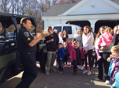 Sgt. Chuck Caputo gives a tour of the Milton Police Station to the MHS Pre-K students