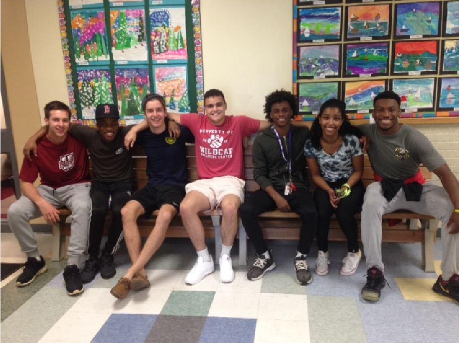 From left: Former Tucker students Ethan Walko, Doumick Metayer, Joe Morfin, Matt LaBelle, Micah Wickham, Sydney Barros, Kobe Osazee